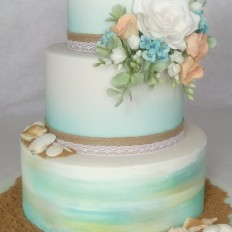 Beach themed wedding cake with sugar shells & sugar flowers