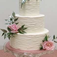 Buttercream textured wedding cake, rose gold fresh flowers
