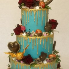 Chocolate lollipop & drip wedding cake, buttercream coated, golden snitch & fresh flowers