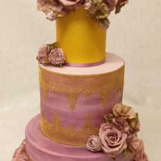 Lilac & mauve watercolour painted wedding cake, edible gold lace and artificial flowers