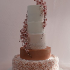Luxury Blush & Rose Gold Ruffle Wedding Cake with  Diamante Centred Sugar Cherry Blossom