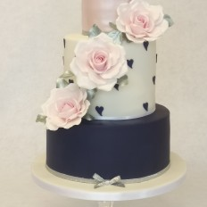 Navy, white & lustre pink wedding cake with large vintage sugar roses
