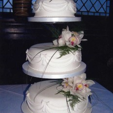 Fresh Orchids & Swags Wedding Cake