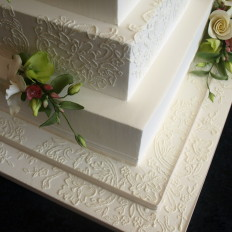 Brush embroidered royal iced wedding cake & sugar flowers