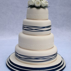 Ivory silk roses & royal iced cornelli wedding cake