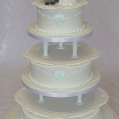 Royal Iced, Intricate Piped Lace Collar, Bride & Groom Handmade Models with Shark Wedding cake