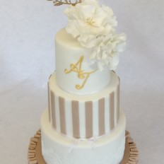 Ruffles, stripes, sugar flower luxury wedding cake